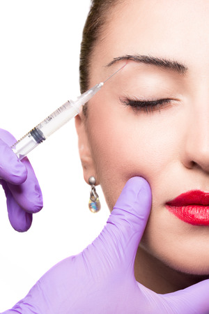 gets: Woman gets cosmetic injection. Beauty Treatment
