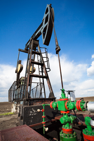 Oil industry pump jack close up photo