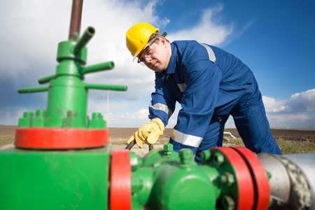 pipelines: Worker on the oil field. Refinery, oil and gas Stock Photo