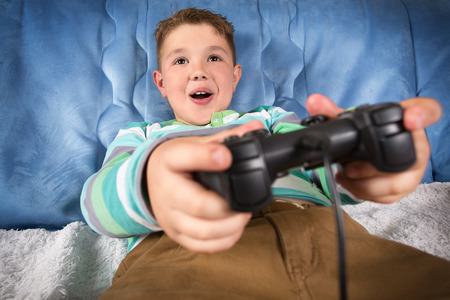 playing video games: Little boy playing video games