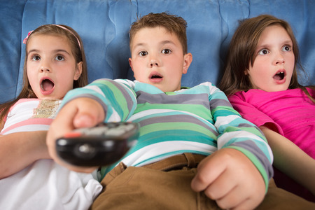 televisions: Surprised children watching TV Stock Photo