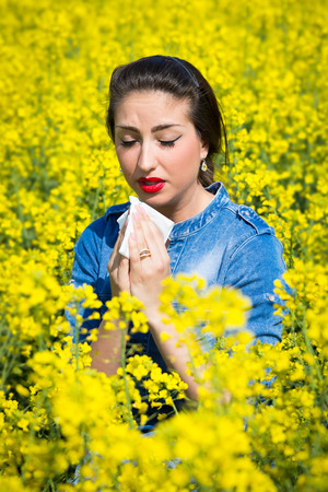fever plant: Young woman in a field has hay fever