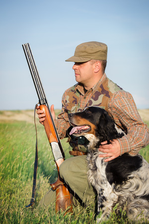 Hunter with a dog on the field Stock Photo