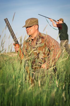 holding gun to head: Hunter wild duck hunting