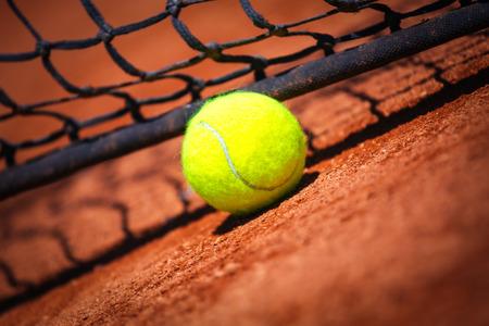 Tennis ball on tennis court Standard-Bild