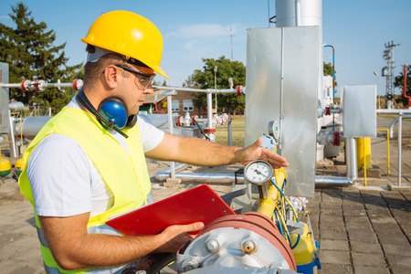 engineering and technology: Oil worker in industrial oil Stock Photo