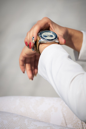 checking time: Businesswoman checking time