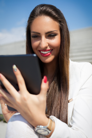 modern businesswoman: Beautiful modern businesswoman holding tablet computer Stock Photo