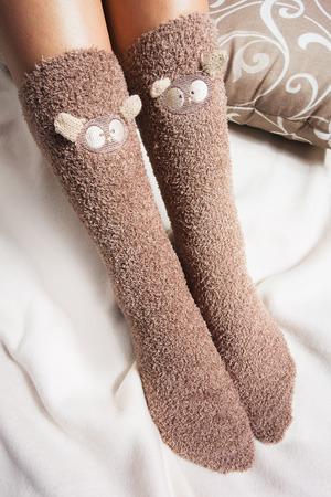 legwarmers: Legs of girl in warm woolen socks