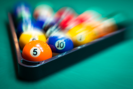 snooker hall: Blurry and moving of billiard balls