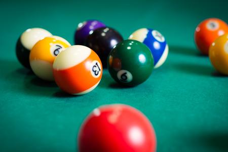 9 ball billiards: Billiard balls in a pool table Stock Photo