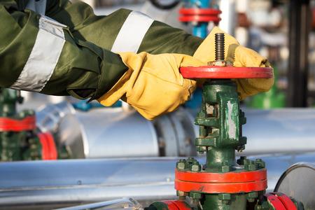 valve: Oil worker turning valve