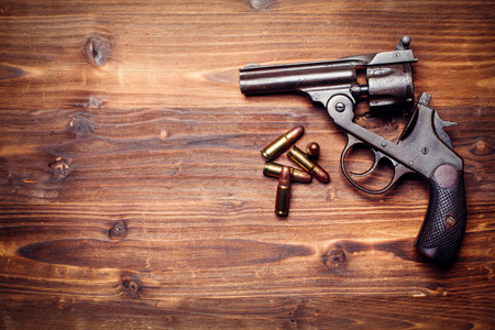 pistols: Vintage pistols on wooden background Stock Photo