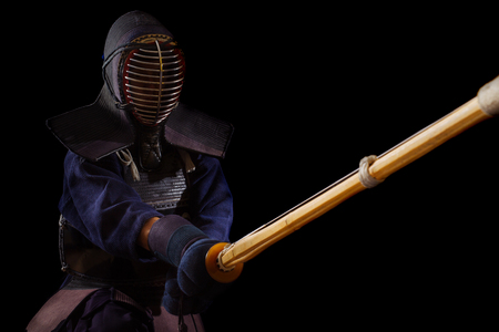 Portrait of man kendo fighter with bokuto