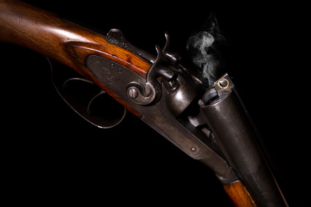 antique rifle: Smoke from a hunting rifle after firing