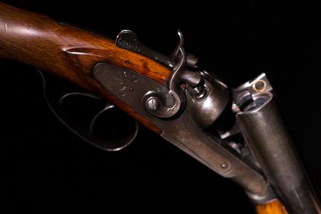 Double-barreled shotgun on a black background
