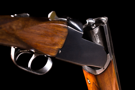 antique rifle: Double-barreled shotgun on a black background