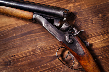 antique rifle: Shotgun on wooden background