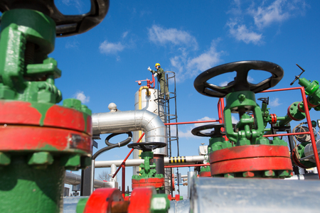 Oil and gas worker inside large petrochemical oil refinery Stock Photo