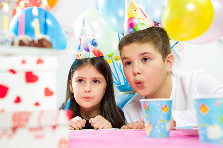 Happy group of children having fun at birthday party photo