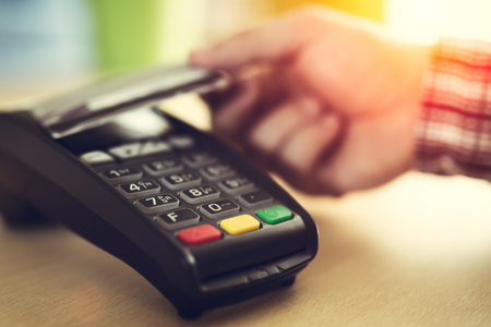 Customer paying credit card with NFC technology