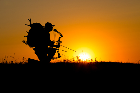 Silhouette of a bow hunter 스톡 콘텐츠