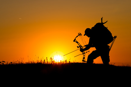 Silhouette of a bow hunter photo
