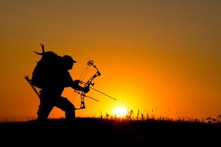 Silhouette of a bow hunter Foto de archivo