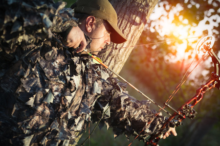 Modern Bow Hunter Stock Photo - 84394294