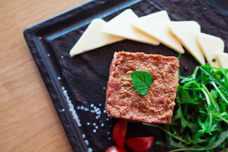 Tatar beefsteak. Restaurant dish concept