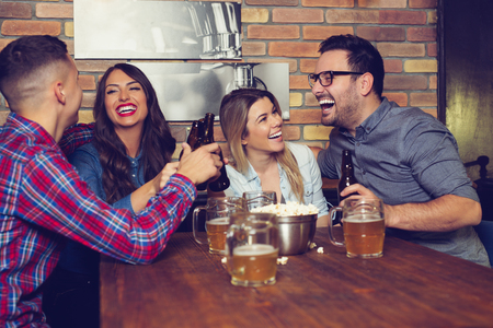 Two couples went on a double date to pub on a saturday night. - Image