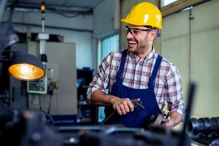 Industrial factory employee working in metal manufacturing industry