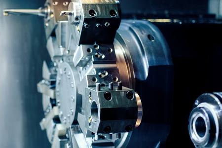 Close up of the CNC lathe. Hi-precision CNC machining concept. Stockfoto