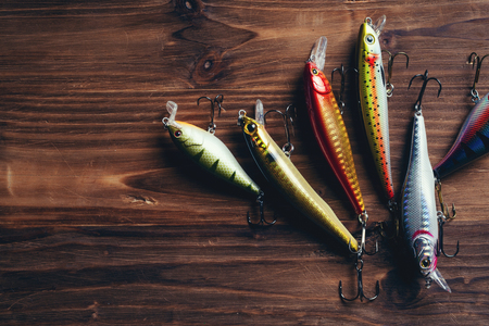 Fishing tackle on a wooden table Imagens