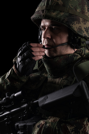 Soldier special forces with rifle on dark background 스톡 콘텐츠