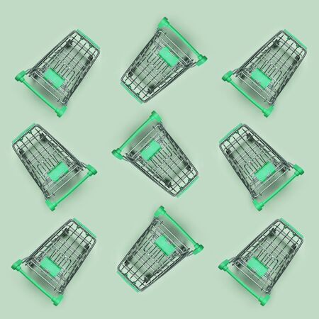 Pattern of many small shopping carts. Minimalism flat lay top view