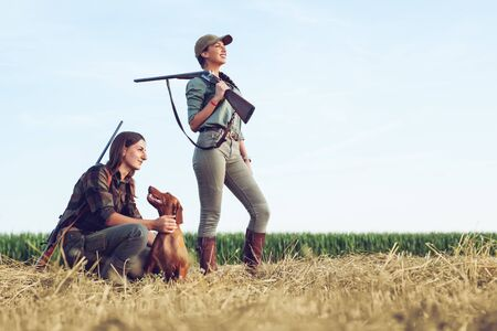 Women hunters with hunting dog Stock Photo