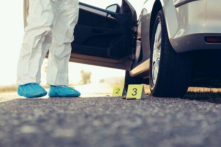 Criminologist investigates a crime scene. Banco de Imagens