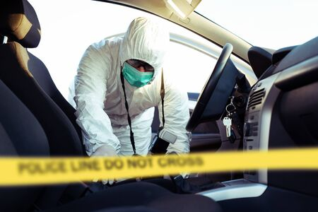 Forensic Science. Criminologist investigates a crime scene.