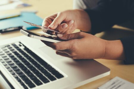 Shopping and online payment by using notebook.