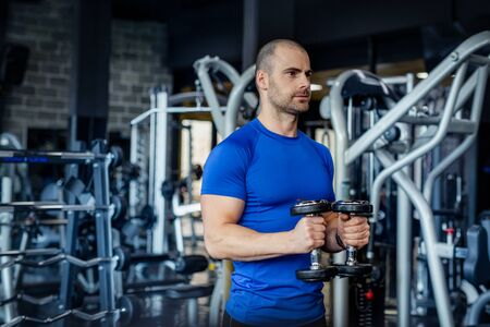 Muscular man working out in gym.