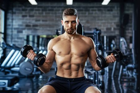 Muscular man during workout in the gym.