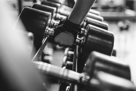 Black and white images Hand holding dumbbell in the gym bodybuilding Standard-Bild