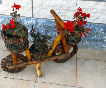 A wooden bicycle decorated with flowers