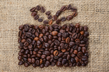 Present made of coffee beans on sackcloth Stock Photo