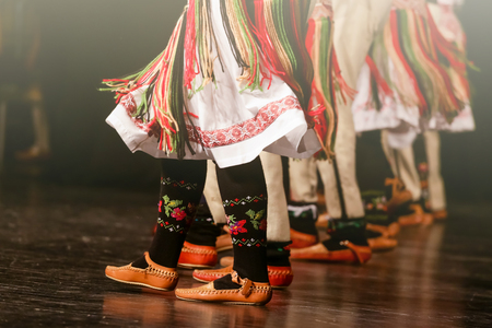 Young Serbian dancers in traditional costume. Folklore of Serbia.