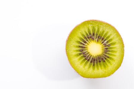 Close up detail of green fresh kiwi fruit on white background.