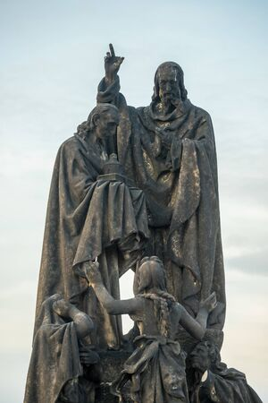 Saints Cyril statue on Charles Bridge in Prague, Czech Republic. Medieval Gothic bridge, finished in the 15th century, crossing the Vltava River