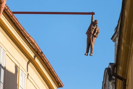 Prague, Czech Republic - July 23, 2019: Man Hanging Out sculpture by the famous czech sculptor David Cerny in the old town of Prague