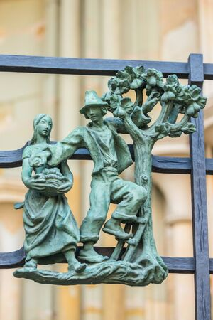 Decorations figure on the gothic gate fence at St. Vitus Cathedral in Prague Stock Photo